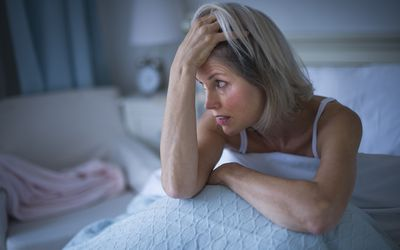 woman with insomnia in bed