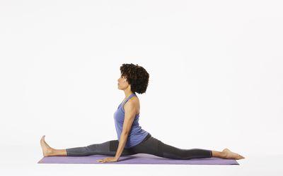 Woman on yoga mat in monkey pose