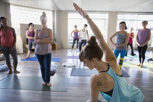 Yoga instructor demonstrating modified side angle pose