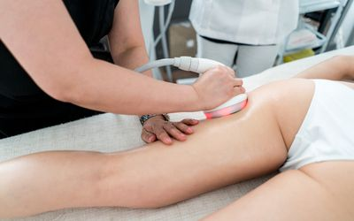 bf3ea550e70 Woman getting an anti-cellulite lase treatment at the spa