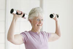 a senior woman lifting free weights