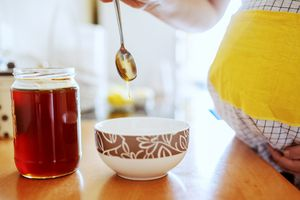 Pregnant woman eating honey