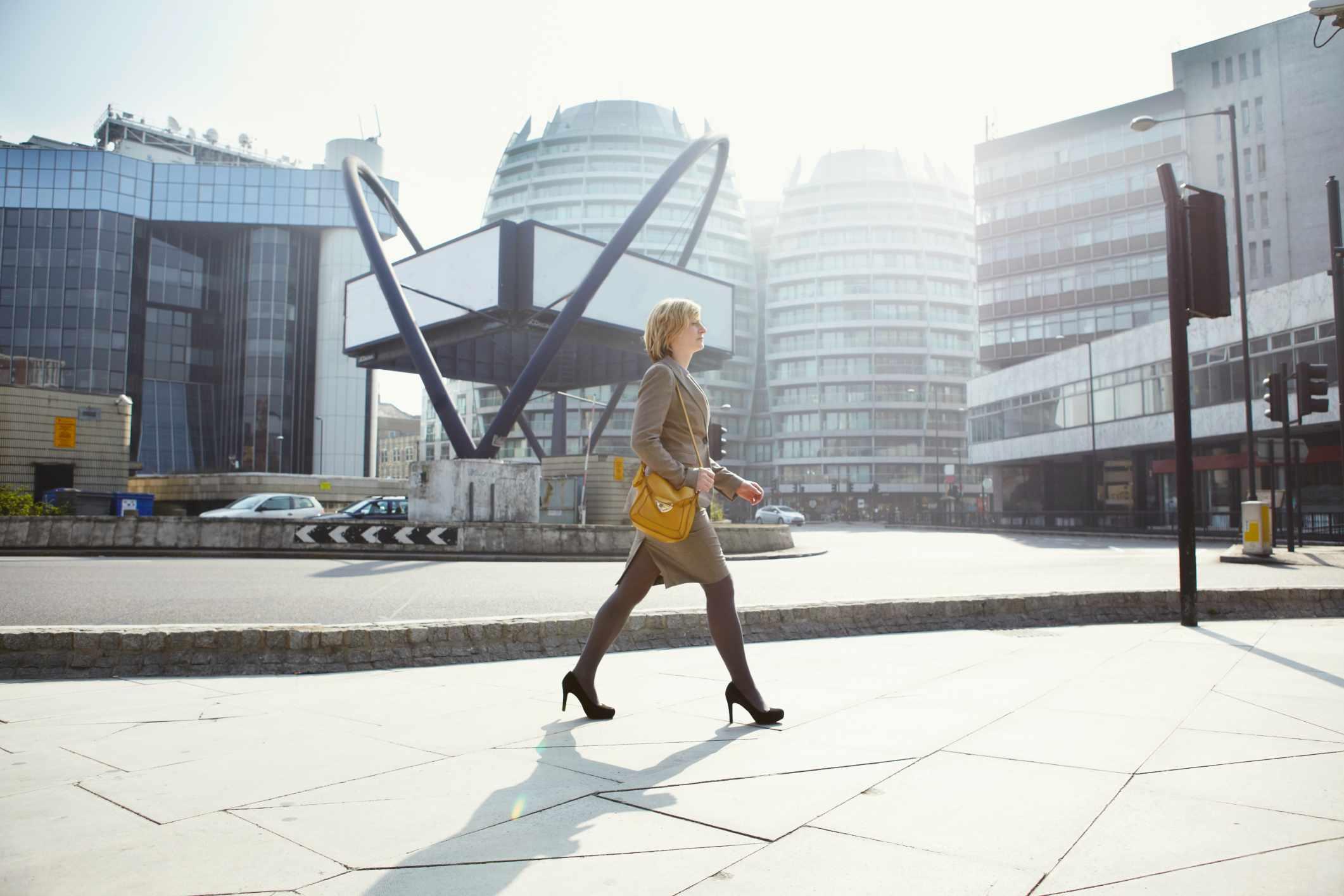 Businesswoman walking to work