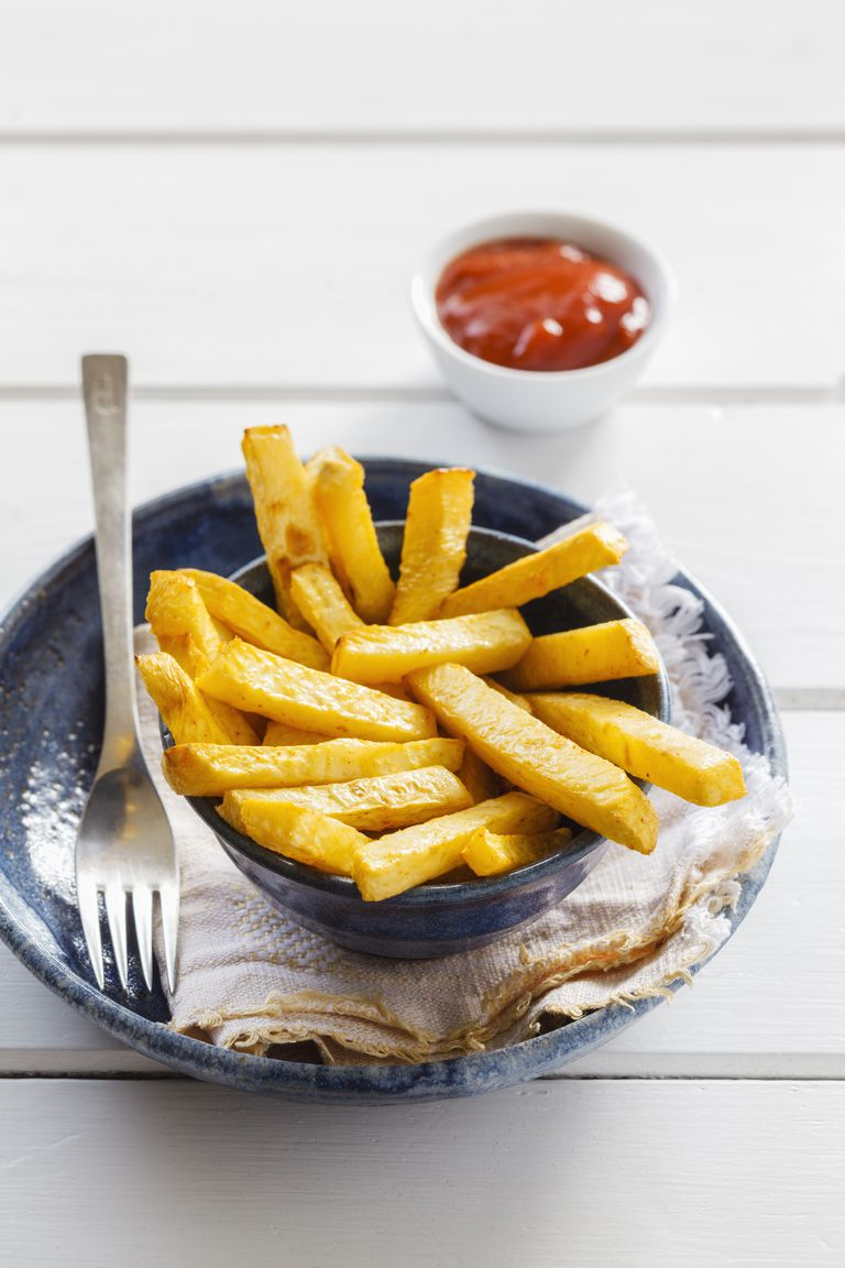 Bowl of swede fries and bowl of ketchup