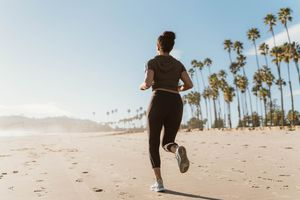 woman jogging on the beach in the morning