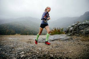 woman trail running with compression socks