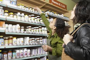 Saleswoman helping customer in health food store