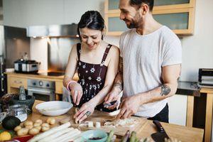Mature couple preparing food for dinner