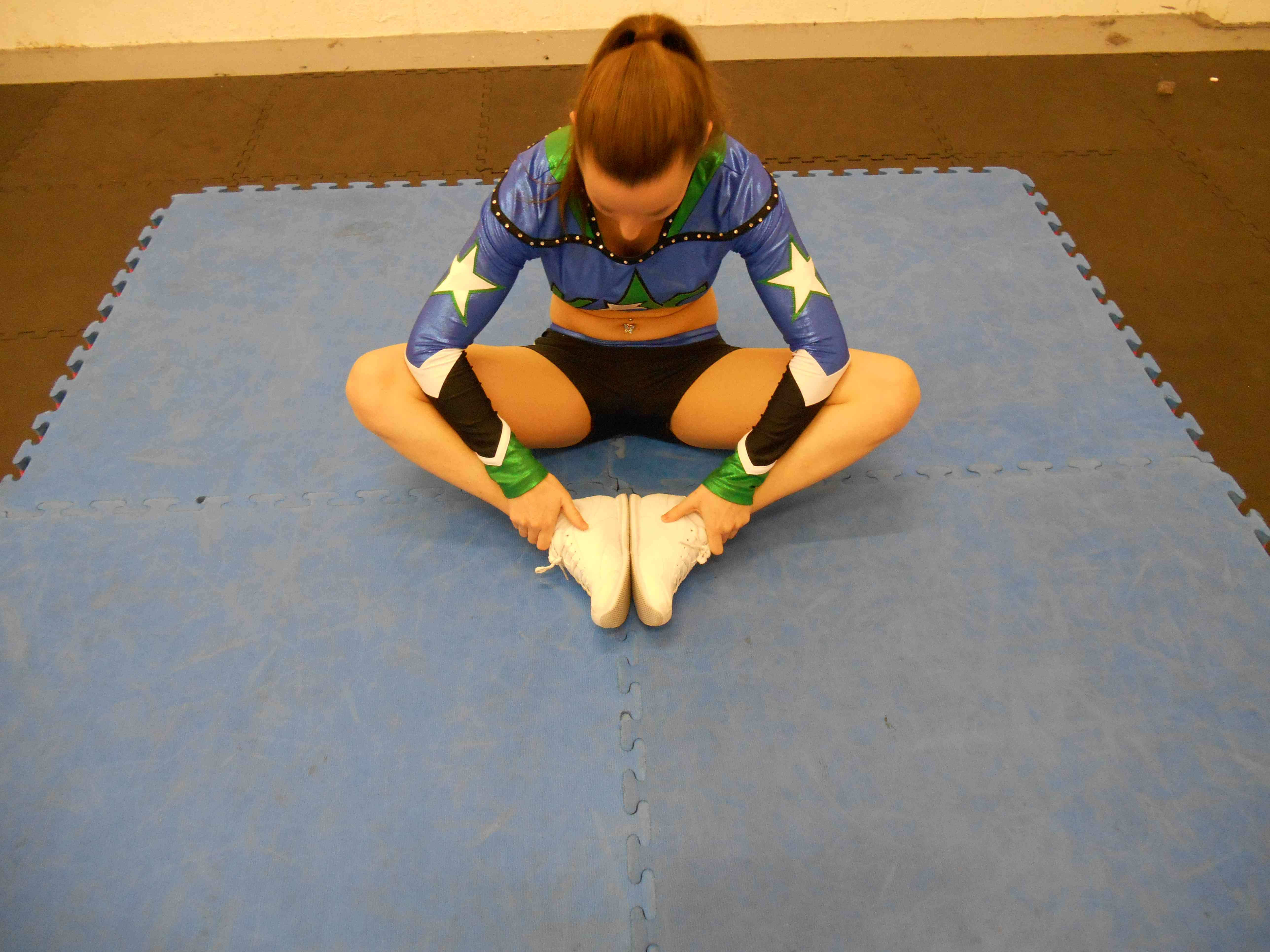 young girl doing hip opener stretch