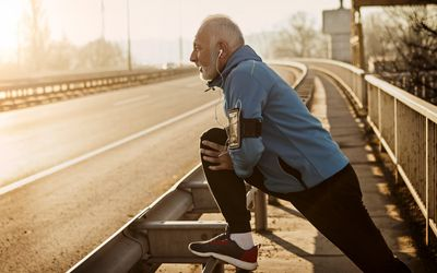 Older man stretching before a run