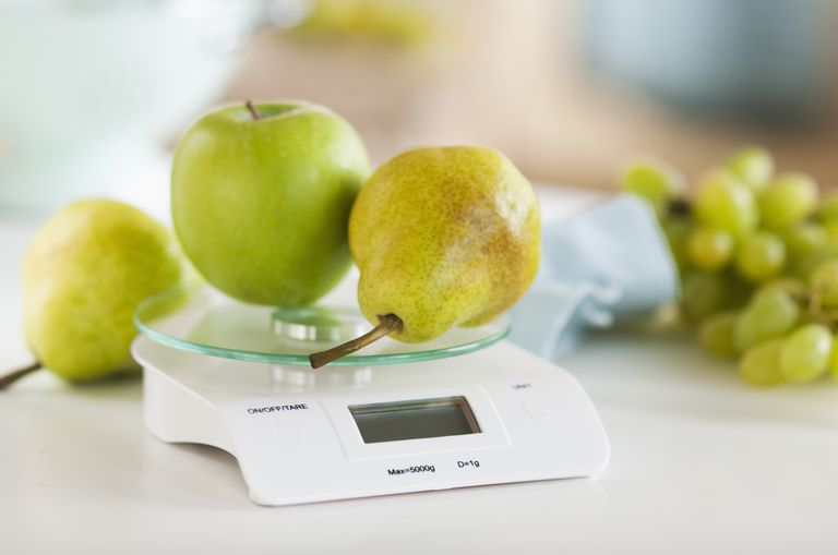 USA, New Jersey, Jersey City, fresh fruits on weight scale