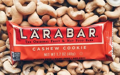 Cashew cookie Larabar sitting on cashews