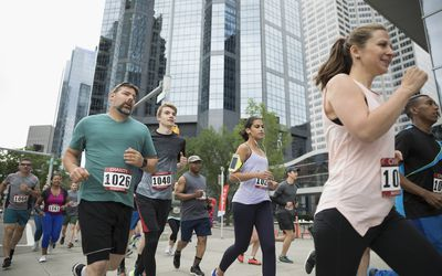 Marathon runners running on urban street