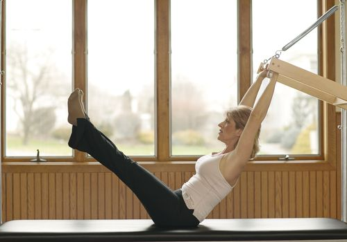 Woman doing Pilates exercise