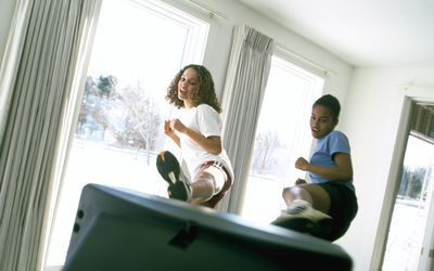 Women Working Out in Front of Television