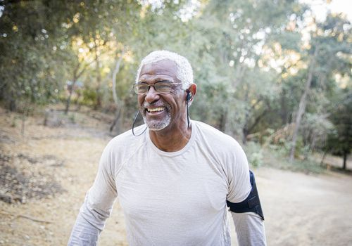 Man walking for fitness in the woods