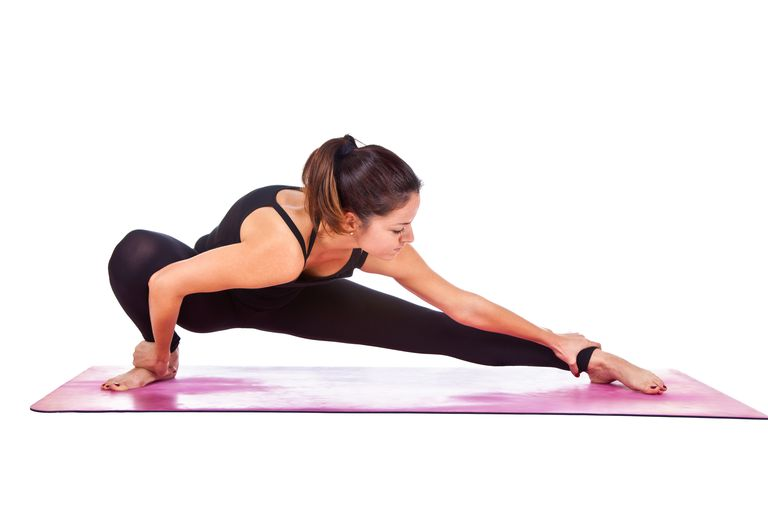 Beautiful woman doing Skandasana pose