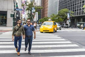 Walking Mature Adult Gay Men Crossing the Street While Holding Hands in New York