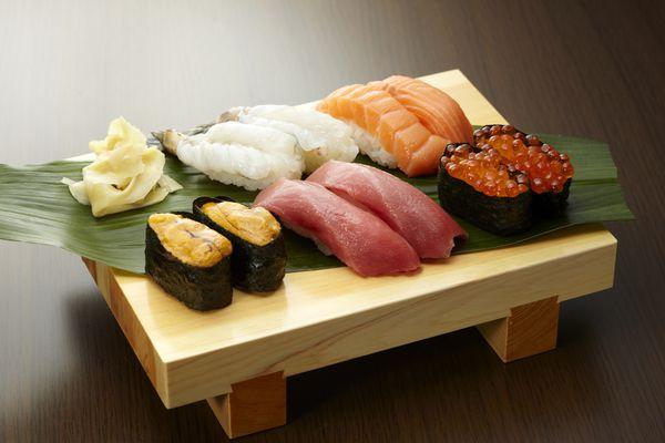 sushi assortment on wooden platter