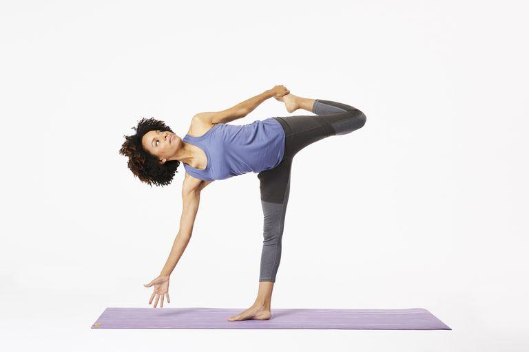 Woman on yoga mat doing sugarcane pose