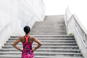 Young athlete looking up concrete stairs