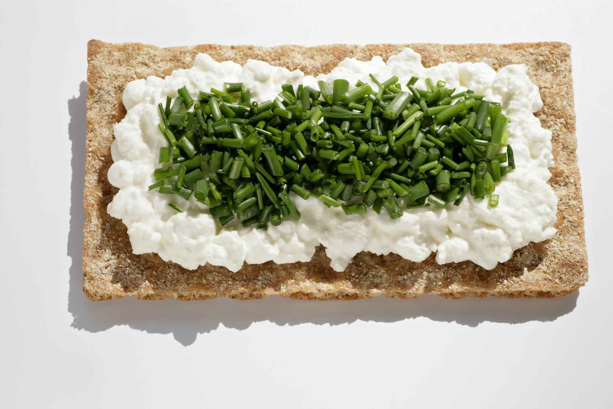 Crispbread, cottage cheese and chives make a healthy snack for work.