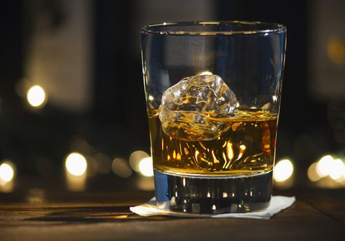 glass of bourbon on ice