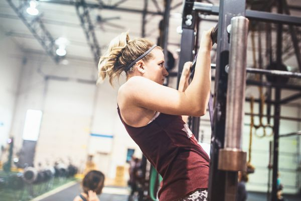 Young woman doing pull ups