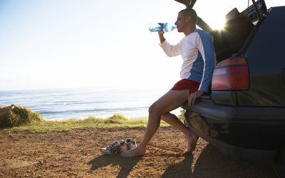 Man drinking water and resting after exercise