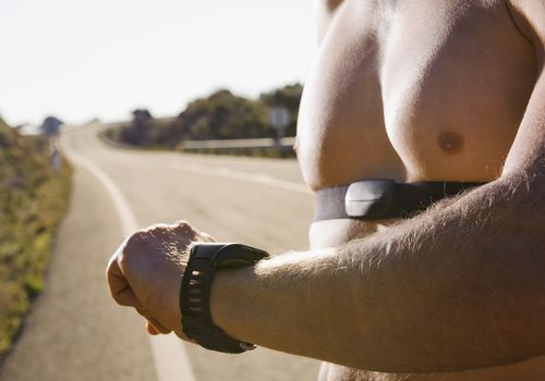 Runner Checking Heart Rate Monitor
