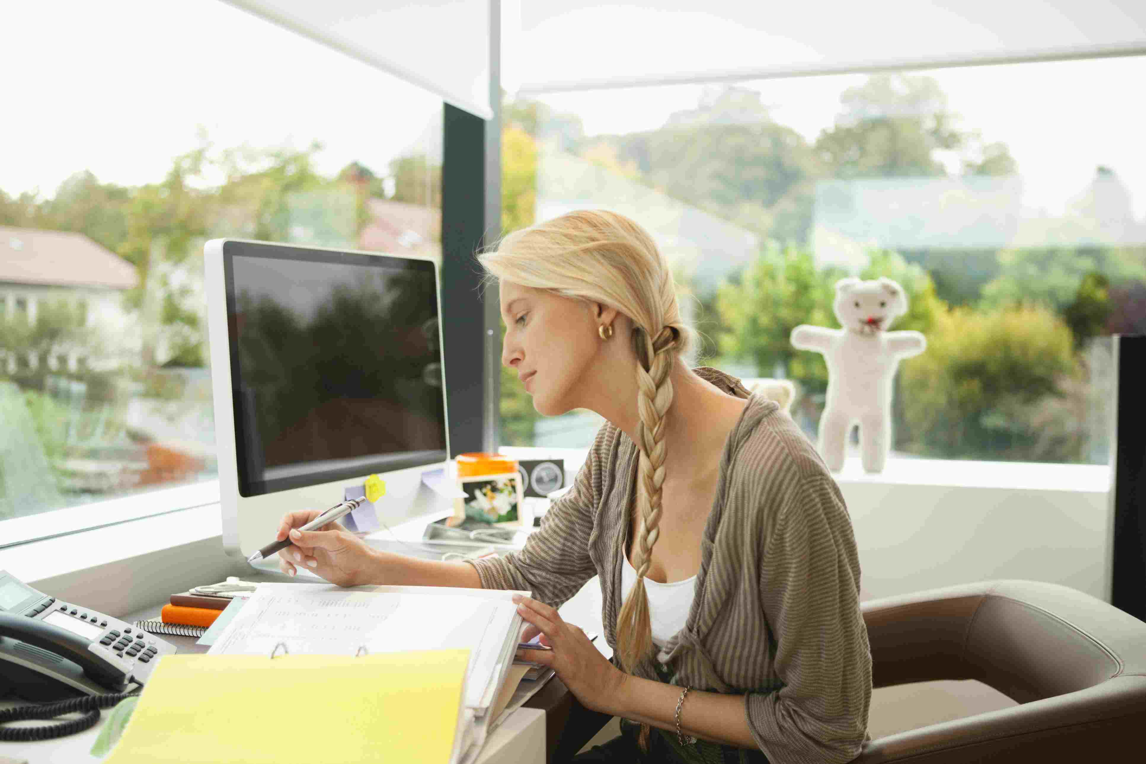 Woman sitting at desk working