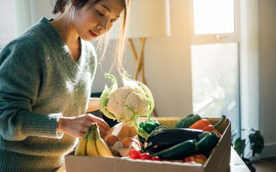 Woman selecting vegetables