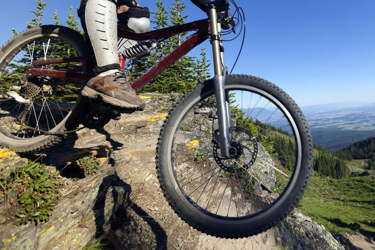 Man downhill mountain biking at Whitefish Mountain Resort in Northwest Montana