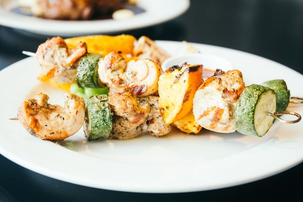 grilled chicken and zucchini skewers on a plate