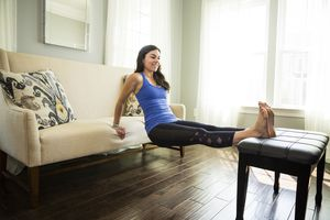 Woman Doing Dips on a Couch