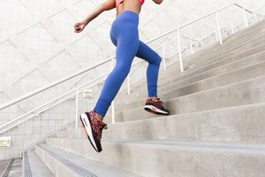 woman running up stairs wearing leggings