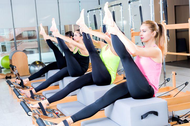 Women in a Pilates reformer class