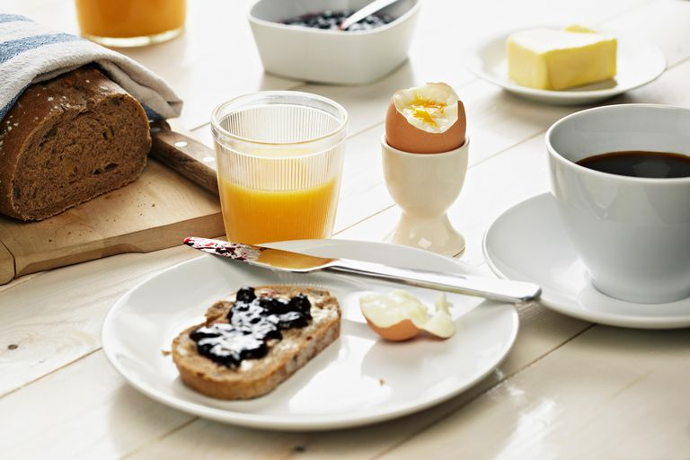 Breakfast with toast, egg, coffee and orange juice