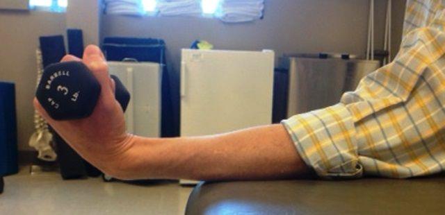 Man performing wrist flexion exercise
