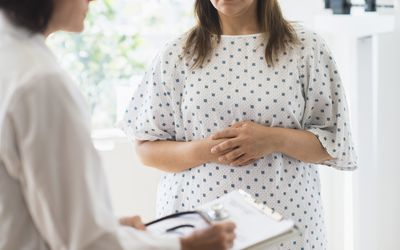 woman consulting with doctor in office