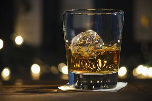 glass of bourbon on ice