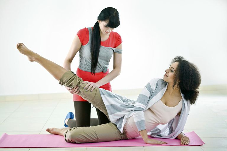 Pregnant woman with her physical trainer