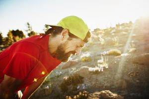 Trail runner breathing hard after run on mountain
