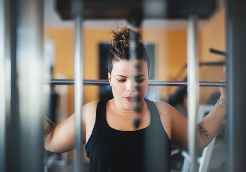 Woman weight lifting at the gym