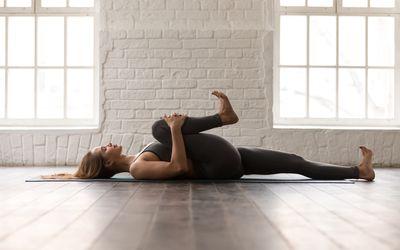 woman performing lying hip flexor stretch