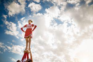 Cheerleader standing on other cheerleaders