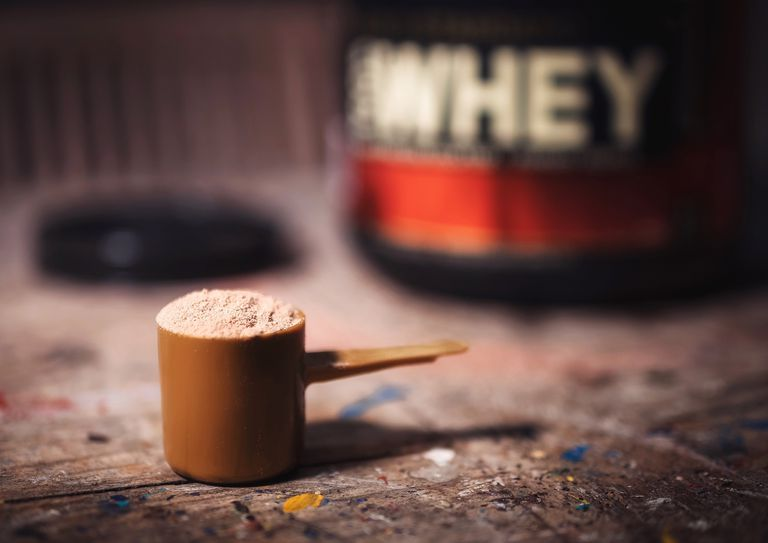Close-Up Of Protein Powder In Scoop On Table