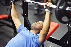 man bench pressing in gym