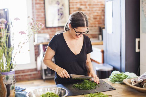 Woman chopping broccoli