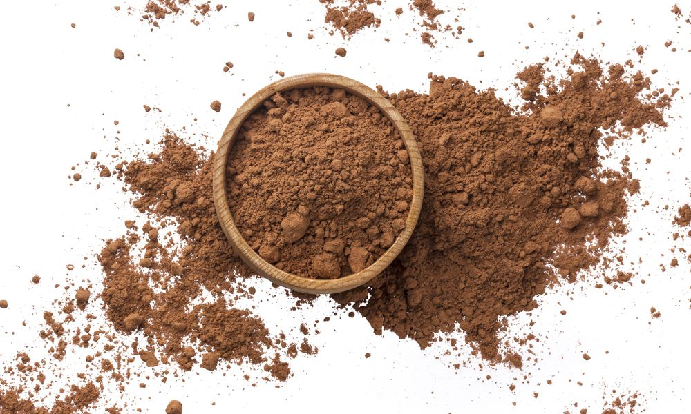 Pile of cocoa powder isolated on white background. Top view